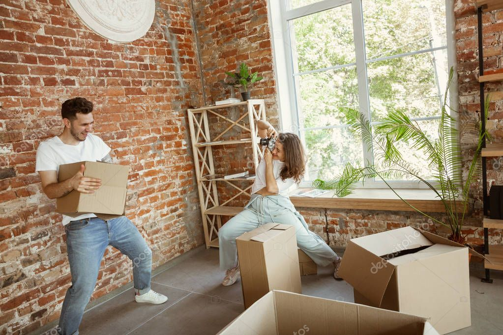 depositphotos 294814912 stock photo young couple moved to a